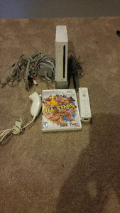 NINTENDO WII INCLUDES REMOTE AND NUNCHUK AND 1 GAME