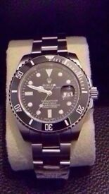 rolex submariner black face, brushed steel sapphire glass. 2.5 x date mag, same weight waterproof