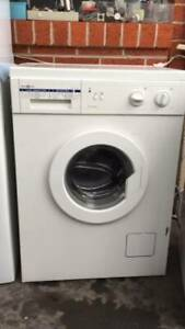 5.5 kg italy name front washing mahcine   clean AND GOOD WORKING.   Di