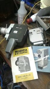 2 antique 8mm video cameras with manuals & projector + screen
