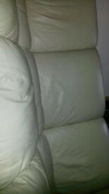 2 sets of white sofas and an orange foot stool