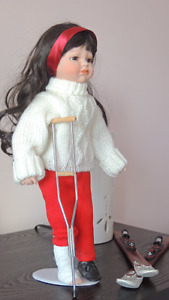 Skiing accident porcelain doll