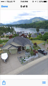 Mortgage helper custom home with fabulous lake & mountain views
