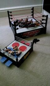 Two Wrestling rings with wrestlers