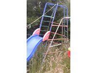 large metal climbing frame with slide