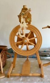 Castle style, single treadle, craftsman made spinning wheel.