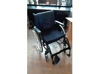active mobility quickie Life R wheelchair all black with puncture proof wheels