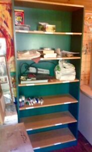 Large green bookcase.