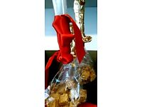Flamboyant Favors by Artistic Creator who designs, delivers and dresses your table.