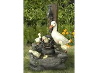 Duck family at tap water feature wit LED lighting fountain