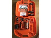 Paslode impulse IM65 F16 Nail gun with accessories in case.