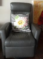 beautiful grey leather swivel recliner rocking easy chair.