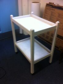 Small two tier table on wheels