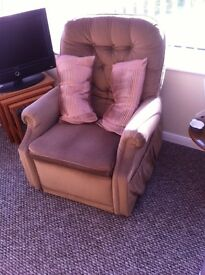 Reclining Armchair. Tilts back with extended footrest (not electric). Cloth finish. Good condition.