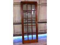 2 doors heavy mahogany type wood, glass paneled