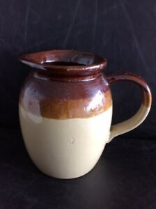 Earthenware jug, 6 inches high, $10