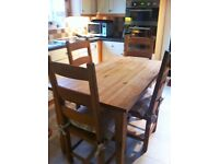 Solid Oak Table With Four Chairs - Oblong length 54 Inches Width 29.5