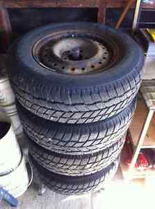 4 Hanook studded winter tires and rims 215/70R15