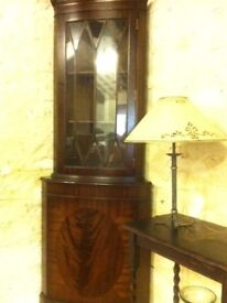 Corner unit with glass display cabinet.