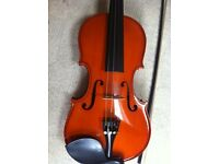 Student 4/4 full size violin complete with new bow and case.