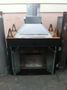 Double sided glass woodstove