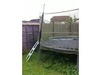 13 ft diameter trampoline with safety net; 10 years out in all weathers but perfectly useable