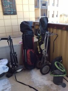 2 sets of Wilson golf bags and equipment $150 Each