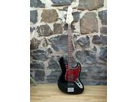 VINTAGE REISSUED SERIES V96 BASS GUITAR AND CASE BLACK AND RED