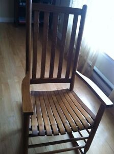 Solid wood rocking chair in good condition.