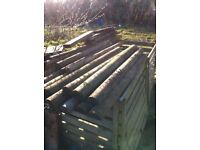 Half round and round fence posts £30 the lot