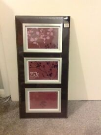 """BROWN LEATHER FRAME WITH 3 7""""X5""""; PHOTOS"""