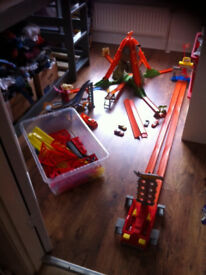 3x Hot Wheels tracks, plus 4 cars, extra track and tesco own brand track