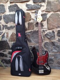 VINTAGE REISSUED SERIES V96 BASS GUITAR AND CASE BLACK AND RED PRICE OR BEST OFFER