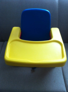 Booster chair with feeding tray