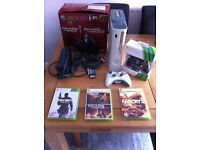 Xbox 360 with 60gb, 3x controllers and 4x games.