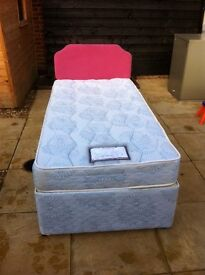 Single divan bed with mattress and optional headboard.