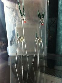 2 beautiful old glass deers given to us from and aunt said to be 1960s