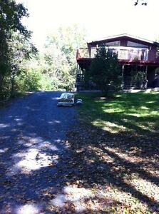 For Rent 2 Bedroom Apt. W/O Wrap around Deck Sharbot Lake Hwy 7