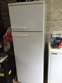 REDUCED FOR QUICK SALE! Bosch fridge/freezer. Full working order. All original shelving/containers