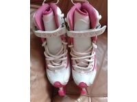 Girls ice hockey skates size 32 with carry bag and guards.