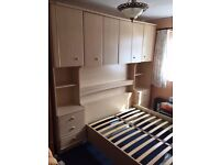 Large Double Bed With Fitted Cupboards and Bed Side Cabinets