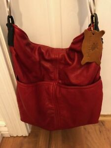 HIDES IN HAND BAG  MADE IN CANADA  NEVER USED