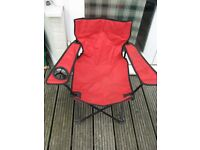 Child's folding red chair