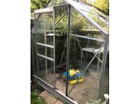 green house 6 ft by 6ft buyer to disassembelle & uplift 1 pane broken