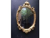 Beautiful gold cherub mirror..vintage
