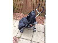 Koochiku Black Pushchair/Stroller With Foot muff and Rain cover - used