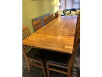 Large Royal oak solid table together with 10 chairs.