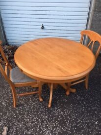 Solid wooden table with 2 chairs