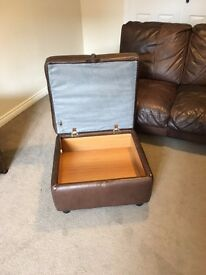 Brown leather sofa and matching storage foot stool