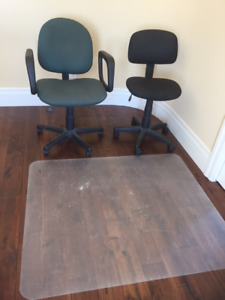 Two comfortable office chairs with one mat